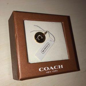 Coach charm.